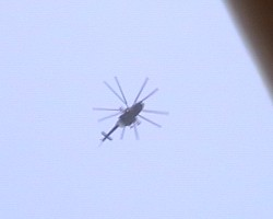 Helicopter gunship flies overhead during our church gathering. Click here on the photograph to see the video
